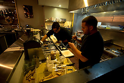 The cooks prepare the food at Pour Wine Bar and Bistro, in the Montclair district of Oakland, Calif., Wednesday, Dec. 23, 2015. (Photo by D. Ross Cameron)