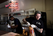MILWAUKEE, WI - NOVEMBER 17: Line cook Ian Pfeiffer, 25, prepares a sandwich at Jake's Delicatessen on Thursday, November 17, 2016.