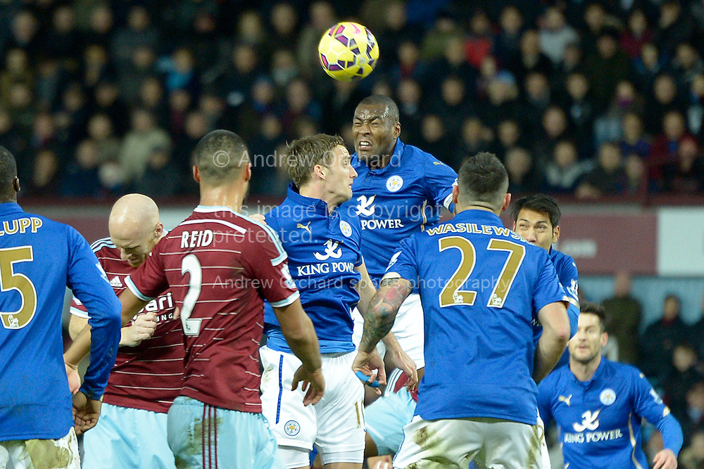 Wes Morgan, the Leicester City captain heads the ball out. Barclays Premier league match, West Ham Utd v Leicester city at the Boleyn ground, Upton Park in London on Sat 20th December 2014.<br /> pic by John Patrick Fletcher, Andrew Orchard sports photography.