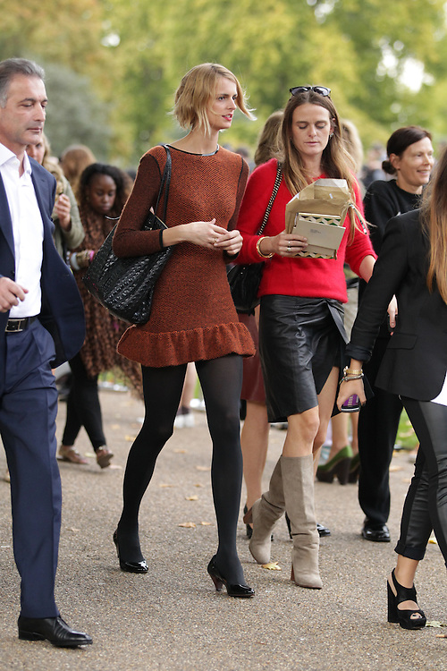 Celebrities and guests arrive at the Burberry spring/summer 2012 fashion show held in Hyde Hark in London.