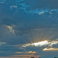 Sun rays fan out from a clouds  over Montana's Gallatin Valley, near Bozeman.