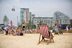 © licensed to London News Pictures. London, UK 23/08/2013. People enjoying the hot weather and playing at Royal Victoria Beach in east London on Friday, 23 August, 2013. Photo credit: Tolga Akmen/LNP