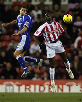 Photo: Paul Thomas.<br /> Stoke City v Cardiff City. Coca Cola Championship. 28/11/2006.<br /> <br /> Roger Johnson (L) of Cardiff and Mamady Sidibe go for the ball.