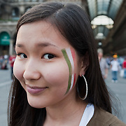 MILAN, ITALY - JUNE 14:  A young Asian girl wearing the colours of the Italian flag on her face at the maxi screen in Piazza del Duomo on June 14, 2010 in Milan, Italy. Italy's national football team managed a draw 1-1 against Paraguay in their first match of FIFA 2010Soccer World Cup.