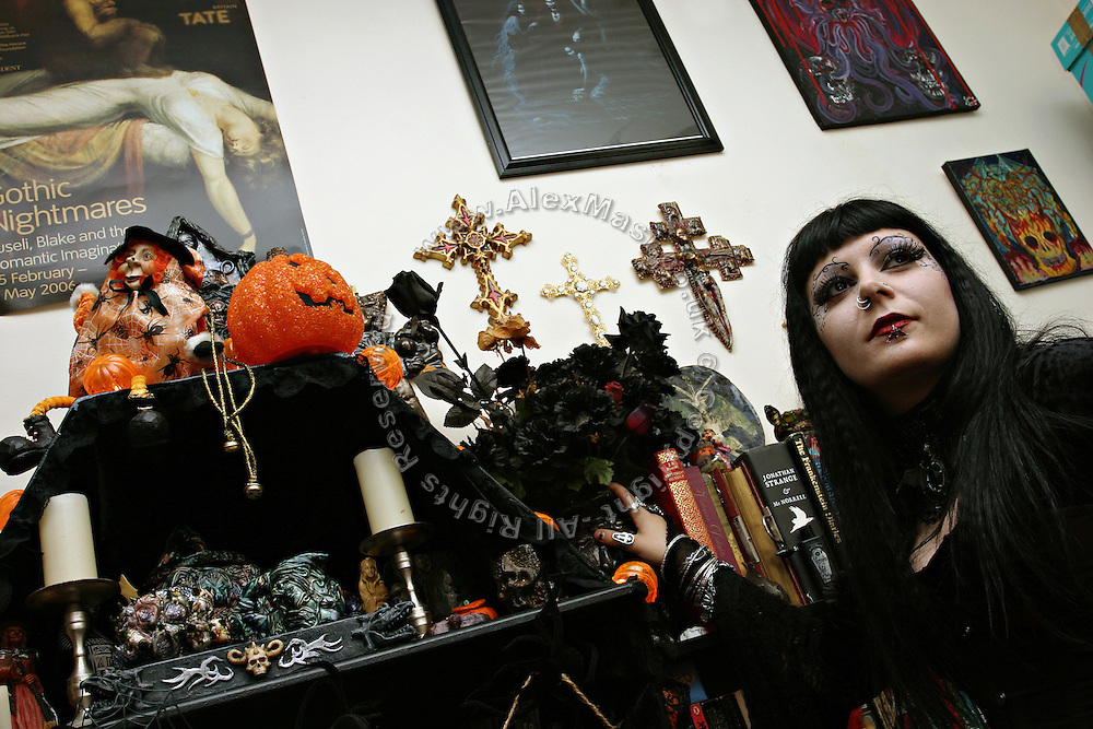 Cecile, 31, a French woman from Avignon, and one of the members in the Vampyre Connexion committee, is standing in her living room on Sunday, 15 October, 2006, in Camden Town, London, England. The Vampyre Connexion is the largest and most active of all the vampire groups in the United Kingdom, counting more than 100 members that for years have gathered regularly in London to share their common love for vampires and the Dark side of life. The Connexion raised from the hashes of the Vampyre Society, the first vampire appreciation group in 1995. The group believe in the fantasy of vampires and such creatures and live it to the full. Its  roots are to be found in the legends of Bram Stokerís Dracula. The group prints its own magazine, ëDark Nightsí featuring drawings, poetry, stories, photography and events. All of the members dress very peculiar clothing, and this is a very important part of the life of the group; it is respected with pride, taste and accuracy for the detail. Most like to dress to be elegant in a range of styles from regency to Victorian, some sew their own. In addition members visit art galleries, cemeteries, churches and cathedrals, attend gigs and concerts, and hold their own parties throughout the year, Halloween being the biggest and scariest one. Membership is open to all, the only qualification: being a love of all things Vampyric. **ItalyOut**