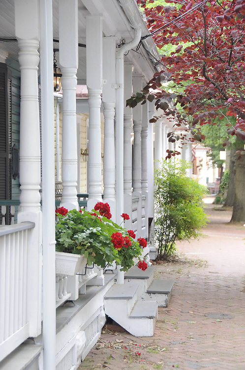 View of Annapolis, Maryland street with repeating front porch rails