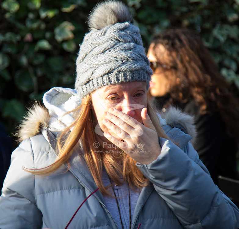 Highgate, London, December 26th 2016. Fans gather outside the London home of pop icon George Michael who died on Christmas day. PICTURED: A woman cries outside Michael's London home.