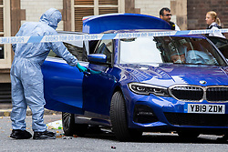 © Licensed to London News Pictures. 28/07/2019. London, UK. Forensic Officers inspect a car in a crime scene on Savoy Hill after a man suffered stab wounds during a mass brawl on Victoria Embankment in the early hours of this morning. One man was arrested for possession of an offensive weapon while five other men were arrested for violent disorder . Photo credit: George Cracknell Wright/LNP