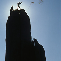 Climbers toss a rappel rope from the summit of Eichorn's Pinnacle on Cathedral Peak in Yosemite National Park, California.