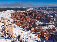 The brilliant hoodoos of Bryce Canyon, formed by millennia of freeze thaw cycles breaking apart the rock, show off the fresh snow.