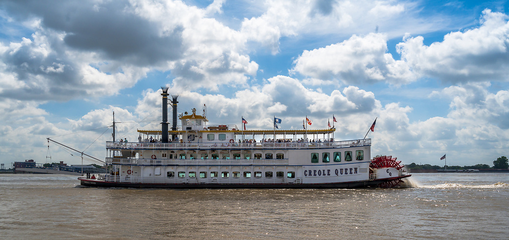 New Orleans, Louisiana, USA -- May 27, 2019.  The paddle wheel tourist boat Creole Queen on the Mississippi River.