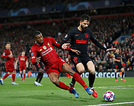 Georginio Wijnaldum of Liverpool tackled by Felipe of Atletico Madrid  during the UEFA Champions League match at Anfield, Liverpool. Picture date: 11th March 2020. Picture credit should read: Darren Staples/Sportimage