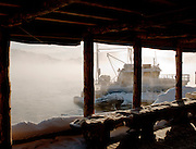 A boat moored in the extreme cold at a lake in Jarfjord, near Kirkeness, Finnmark region, northern Norway