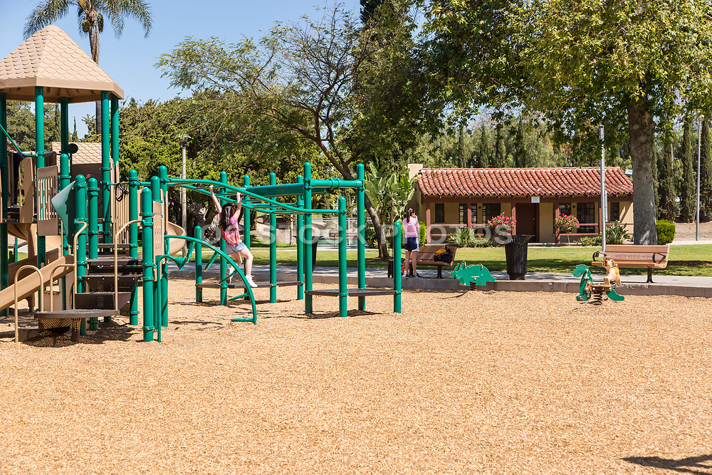 Girl on the Playground Equipment at Hart Park in Orange California