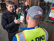 20 MAY 2019 - DAVENPORT, IOWA: BETO O'ROURKE talks to a worker doing mold removal in a flooded business in downtown Davenport. O'Rourke, running to be the 2020 Democratic nominee for the US Presidency, has made climate change a central part of his campaign. He toured flood damage in Davenport Monday. The Mississippi River flooded through downtown Davenport on April 30 and much of downtown is still recovering from the flood.       PHOTO BY JACK KURTZ