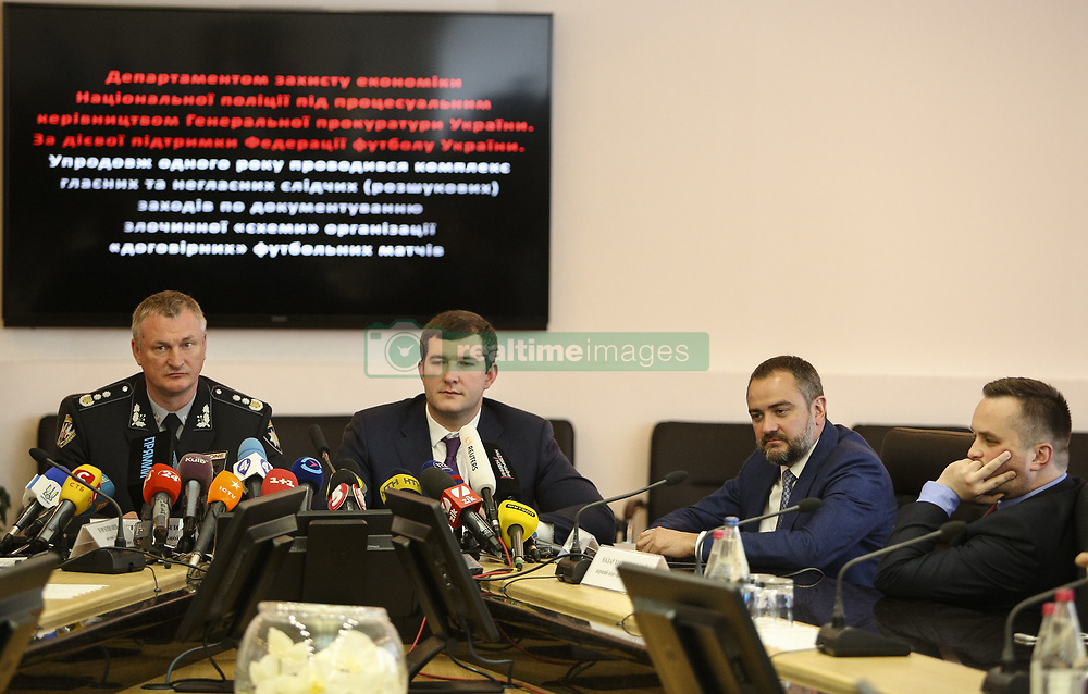 May 22, 2018 - Kiev, Ukraine - National Police of Ukraine head chief Serhiy Knyazev (L), President of Football Federation of Ukraine Andriy Pavelko (2nd R) and the First Vice President of Football Federation of Ukraine Nazar Kholodnytsky (R)  talk to media during the press conference in Kyiv, Ukraine, May 22, 2018. Ukrainian police in cooperation with Specialized Anti-Corruption Prosecutor's Office (SAPO) investigate the case on match-fixing by referees, FC's presidents and top management of National Football Federation. (Credit Image: © Sergii Kharchenko/NurPhoto via ZUMA Press)