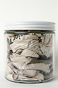 Still life of newspaper in a jar