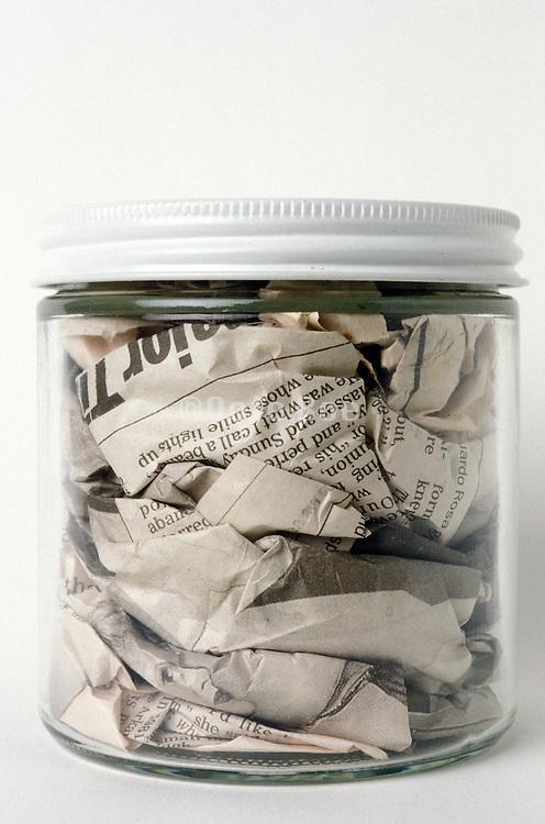 Still life of newspaper in a jar