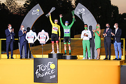 UAE's rider Tadej Pogacar winner of the yellow jersey and the white jersey and the polka dot jersey, and Deceuninck Quick step's rider Sam Benett winner of the green jersey on the podium of the Tour de France 2020, on Champs Elysees Avenue in Paris, on September 20, 2020. / Sportida