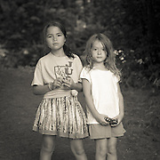 Two young girls standing together