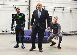 """© Licensed to London News Pictures. 04/04/2013. London, UK (Left to right) Actors Matt Cross, Boris Johnson, Dawson James. Boris Johnson the Mayor of London, visits Ealing studios today, 4th April 2013, where he announced his plans to boost London's TV, Animation and Film industries, capitalising on the new tax relief brought in by the Chancellor (from 1st April 2013) to bring major jobs and investment to the capital. He toured the Studios and spent time in the """"Imaginarium"""", where he had a go at mastering 'performance capture'. . Photo credit : Stephen Simpson/LNP"""