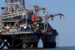 05 May 2010. Venice, Louisiana. Deepwater Horizon, British Petroleum environmental oil spill disaster.<br /> The 'Ocean Saratoga' drilling platform less than 10 miles from the Louisiana coast, approximately 34 miles closer to land than the collapsed Deepwater Horizon rig. Drilling continues at a pace as oil companies strive to build ever more oil rigs in the Gulf. Photo credit; Charlie Varley/varleypix.com