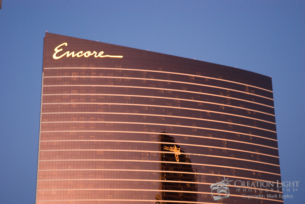 """The Encore is a part of the Wynn Las Vegas Resort and Country Club which is a luxury casino resort located on the Las Vegas Strip in Paradise, Nevada. The 2,034 room hotel had a project cost $2.3 billion. The resort covers 215 acres (87 ha)...The resort features a 74,000 square feet (6,900 m2) casino, 27,000 sq ft (2,500 m2) of retail space in """"The Esplanade"""", a spa and salon, five restaurants, seven bars, as well a nightclub. The building is 631 feet (192 m) in height. The Wynn and Encore towers together have a total of 4,750 rooms."""