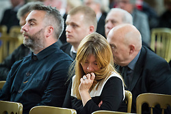 "© Licensed to London News Pictures . 14/10/2013 . Gorton Monastery , Manchester , UK . Mourners sit and listen to music being played during the service . The Humanist funeral of photographer Harry Goodwin , attended by footballers and other celibrities and featuring music by artists he had photographed including ""He Ain't Heavy, He's My Brother"" by the Hollies and "" Happiness "" by Ken Dodd . Photo credit : Joel Goodman/LNP"