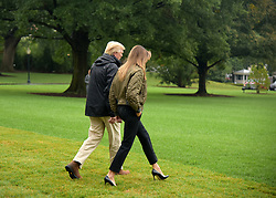 August 29, 2017 - U.S. President Donald Trump (L) and First Lady Melania Trump walk to board Marine One before departing the White House for Joint Base Andrews, en route to Corpus Christi, Texas, in Washington, D.C., the United States. President Donald Trump went to Texas on Tuesday to see the recovery efforts underway in the aftermath of Hurricane Harvey. (Credit Image: © Yin Bogu/Xinhua via ZUMA Wire)