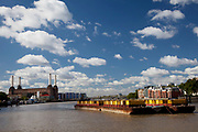 Waste barges on the river Thames near to Battersea Power Station.
