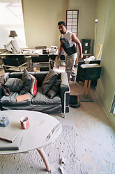 18 September 2001. New York, New York - USA.<br /> Post 9/11 World Trade Center attack.<br /> John Philips is granted special permission to enter his once luxury apartment just 2 blocks from where the World Trade Center Twin Towers used to stand. His apartment is now filled with dust and debris from the collapsed towers. John and residents of the building were evacuated following the attack which cut off water and electricity supplies. A week after the attack, residents were given just 15 minutes to gather necessary belongings and leave their apartments which by default rendered them homeless. Residents were warned to check their balconies for victims of the Twin Towers who might have fallen to their deaths.<br /> In the chaos of 9/11, John's sister Dr Sneha Ann Philip disappeared. John claimed she used to walk past the Twin Towers every morning on her way to work. He fears she might be a victim of the coordinated Al Qaeda attack which claimed over 2,000 victims at the site of the Twin Towers.<br /> It was later discovered that his sister was indeed just one more of the many victims killed in the attack.<br /> Photo exclusive©; Charlie Varley/varleypix.com