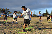 Jovanni Cazarez, 9, works out on a training ladder at Tuesday's CCFA clinic at Cesar Chavez Park in Salinas.
