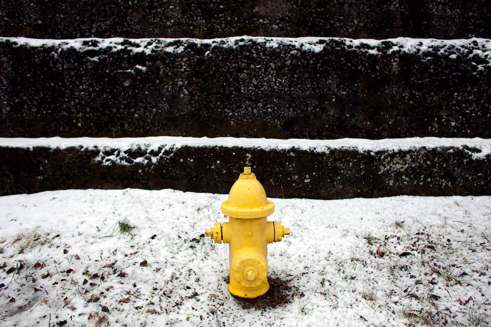 Fire hydrant standing at the foot of a WWII army installation at Sandy Hook National Recreation area.