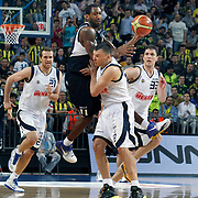 Fenerbahce's Sarunas JASIKEVICIUS (F), Marko TOMAS (R), Oguz SAVAS (L) and Efes Pilsen's Bootsy THORNTON (C) during their Turkish Basketball Legague Play-Off semi final first match Fenerbahce between Efes Pilsen at the Sinan Erdem Arena in Istanbul Turkey on Tuesday 24 May 2011. Photo by TURKPIX