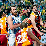 Fenerbahce Ulker's Oguz Savas (C) during their Turkish Basketball league derby match  Fenerbahce Ulker between Galatasaray at Sinan Erdem Arena in Istanbul, Turkey, Friday, December 30, 2011. Photo by TURKPIX