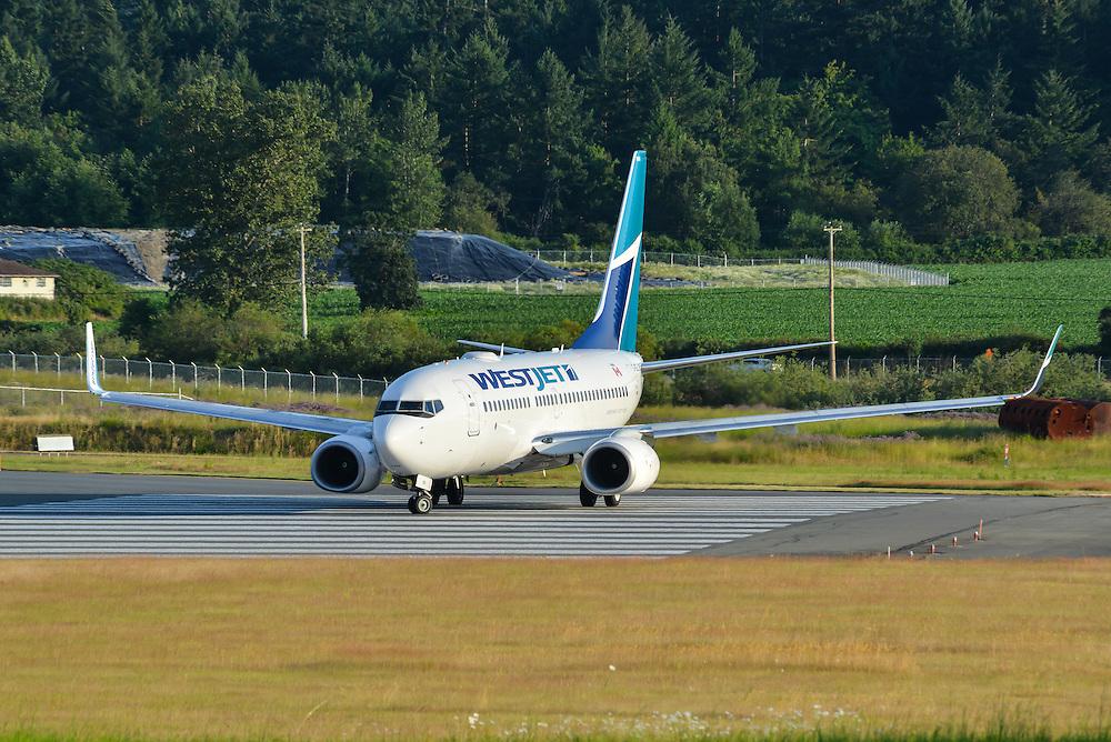 Westjet Boeing 737-700 prepares for take off at CYYJ Victoria