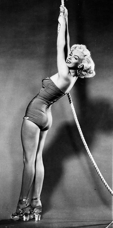 Sep.19 1955 - New York, NY, U.S. - MARILYN MONROE wearing glass shoes and a one piece bathing suit while posing at a photo shoot. (Credit Image: © Keystone Press Agency/Keystone USA via ZUMAPRESS.com)
