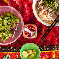 Bún bò huế, a local specialty pork and beef noodle soup,  served at the morning market in Thanh Toan village outside of Hue, Vietnam.
