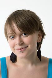 Studio portrait of a teenage girl smiling,