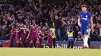 Football - 2017 / 2018 Premier League - Chelsea vs Manchester City<br /> <br /> Manchester City players celebrate with their fans after scoring whilst a dejected Cesc Fabregas (Chelsea FC) walks back at Stamford Bridge <br /> <br /> COLORSPORT/DANIEL BEARHAM