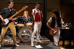 DF-25953 – L-R: Joe Mazzello (John Deacon), Ben Hardy (Roger Taylor), Rami Malek (Freddie Mercury), and Gwilym Lee (Brian May) star in Twentieth Century Fox's BOHEMIAN RHAPSODY.