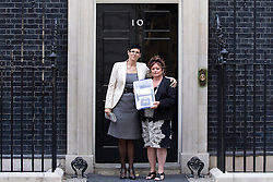"© Licensed to London News Pictures. 31/08/2013. London, UK. Lorraine Etheringon (L) and Lorraine Salvage (R), the sister and cousin (respectively) of prisoner Charles Bronson are seen on the doorstep of Number 10 Downing Street shorty before handing in a petition for his release in London today (31/08/2013). Often referred to in the British press as the ""most violent prisoner in Britain"", Bronson is currently being held on a life sentence in Wakefield High-Security Prison. Photo credit: Matt Cetti-Roberts/LNP"