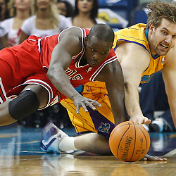 February 12, 2011; New Orleans, LA, USA; Chicago Bulls small forward Luol Deng (9) and New Orleans Hornets center Aaron Gray (34) scramble for a loose ball during the first quarter at the New Orleans Arena.   Mandatory Credit: Derick E. Hingle