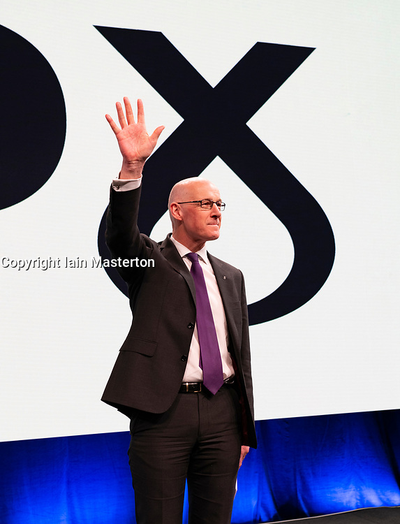 Edinburgh, Scotland, UK. 27 April, 2019. SNP ( Scottish National Party) Spring Conference takes place at the EICC ( Edinburgh International Conference Centre) in Edinburgh. Pictured; Deputy First Minister John Swinney acknowledges delegates' applause at end of his speech  to the conference