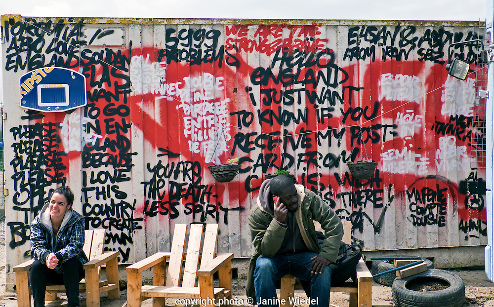 Graffiti with messages in The Calais Jungle Refugee and Migrant Camp in France