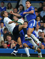 BARCLAYS PREMIERSHIP-19 SEPT-04-CHELSEA v TOTTENHAM-PIC BY KIERAN GALVIN / COLORSPORT-frank lampard goes high on pedro mendes.