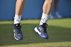 June 19, 2018 - London, England, United Kingdom - Details shoes of Britain's Andy Murray during his first round men's singles match at the ATP Queen's Club Championships tennis tournament in west London on June 19, 2018. Britain's Andy Murray was beaten 2-6, 7-6 (7/4), 7-5 by Australian Nick Kyrgios in the Queen's Club first round. (Credit Image: © Alberto Pezzali/NurPhoto via ZUMA Press)