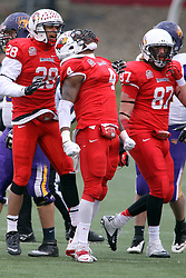 06 December 2014:  Normal Illinois.  David Perkins celebrates a sack with a howl and with Oshay Dunmore and Teddy Corwin during a 1st round FCS NCAA football game between the Panthers of Northern Iowa and the Redbirds of Illinois State in Hancock Stadium.  Illinois State won the game 41-21.