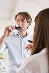 Couple having glass of wine together