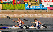 20040827 Olympic Games Athens Greece .[Canoe/Kakak Flatwater Racing] .Lake Schinias - Firday Finals day.GBR K2 Ian Wynne [left] and Paul Darby Dowman, cross the finishing line in the men's K2 1000m Olympics final in seventh position.  .Photo  Peter Spurrier.email images@intersport-images.com...